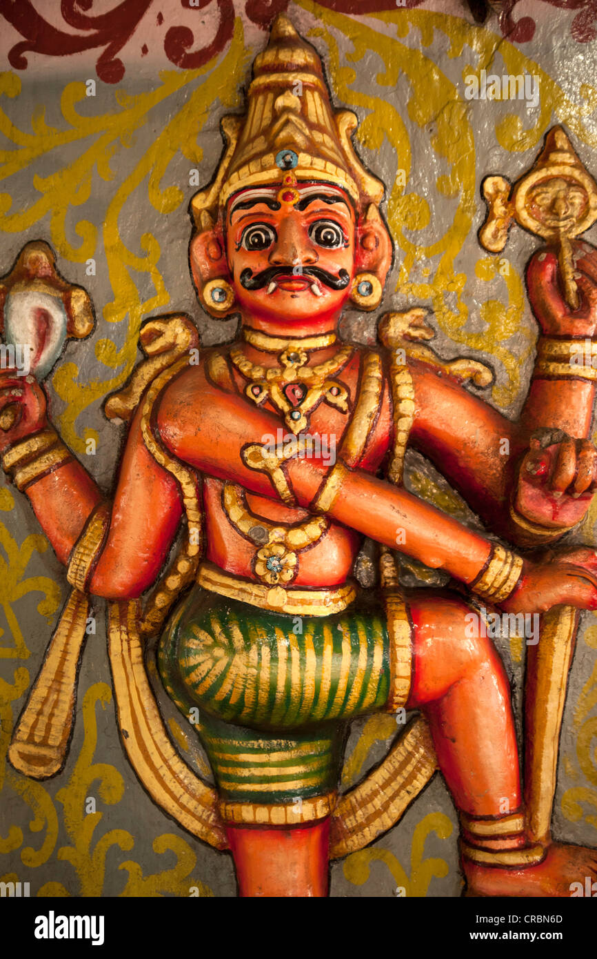 Colorful multi-armed Hindu deity in a Hindu temple in Kandy, Sri Lanka, Asia - Stock Image