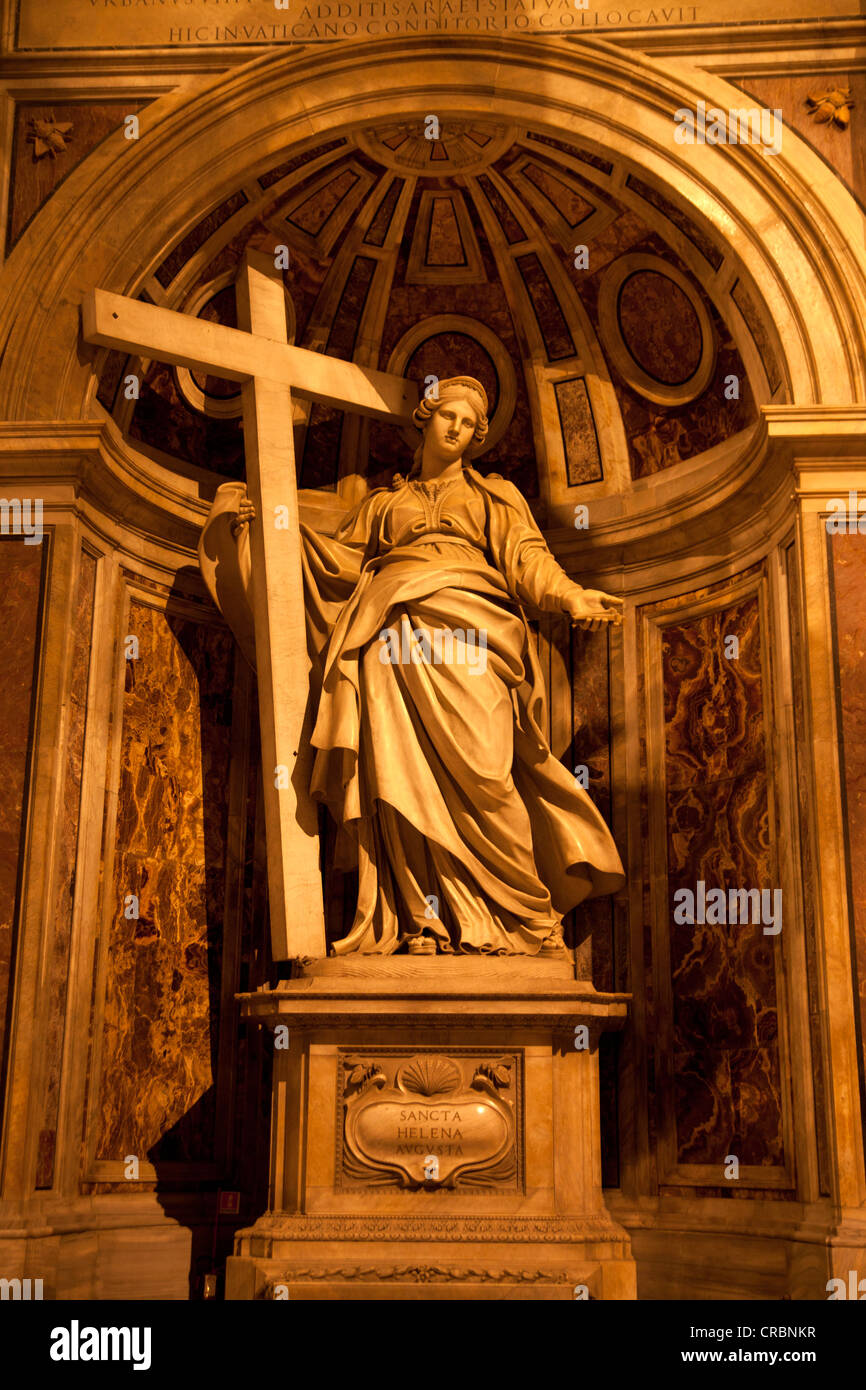 Statue bearing a cross in St. Peter's Basilica, Rome, Italy, Europe - Stock Image