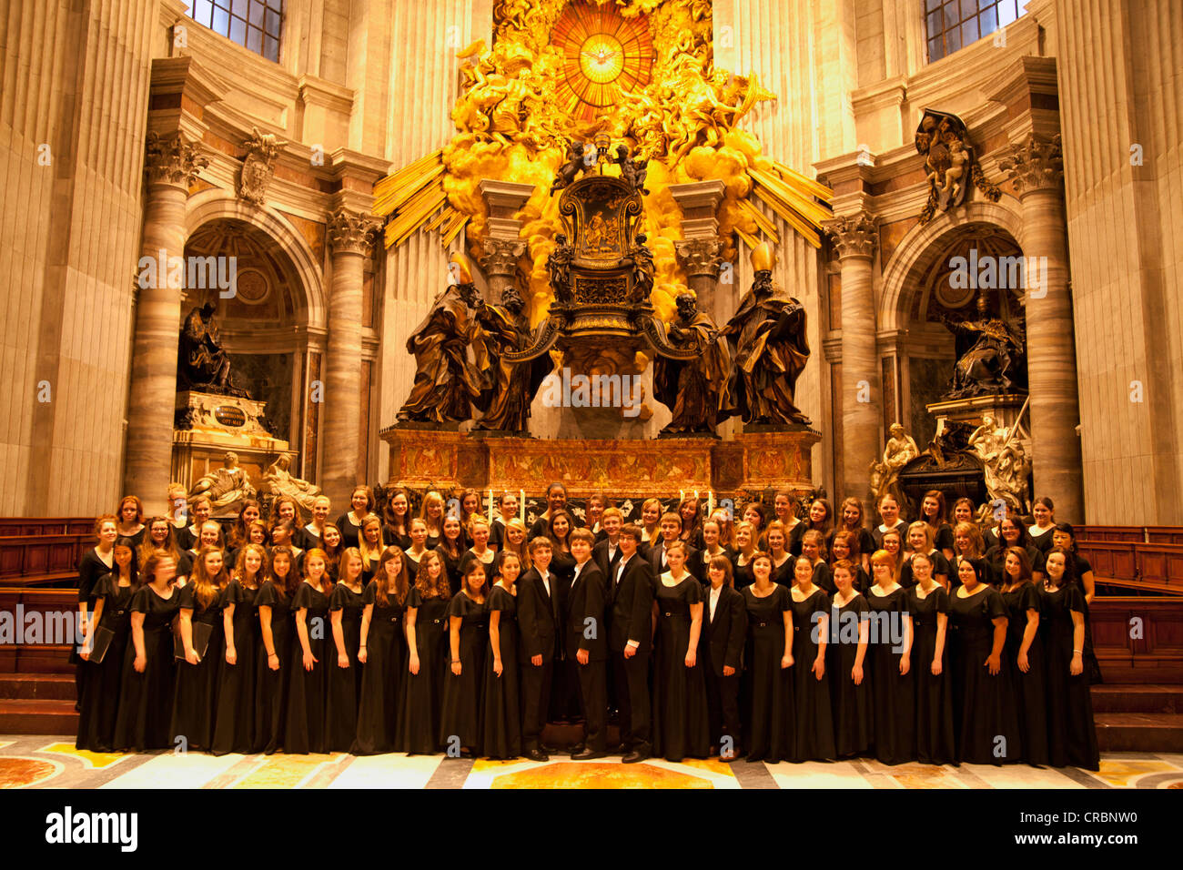 American choir visiting the St. Peter's Basilica, Vatican City, Rome, Lazio, Italy, Europe - Stock Image