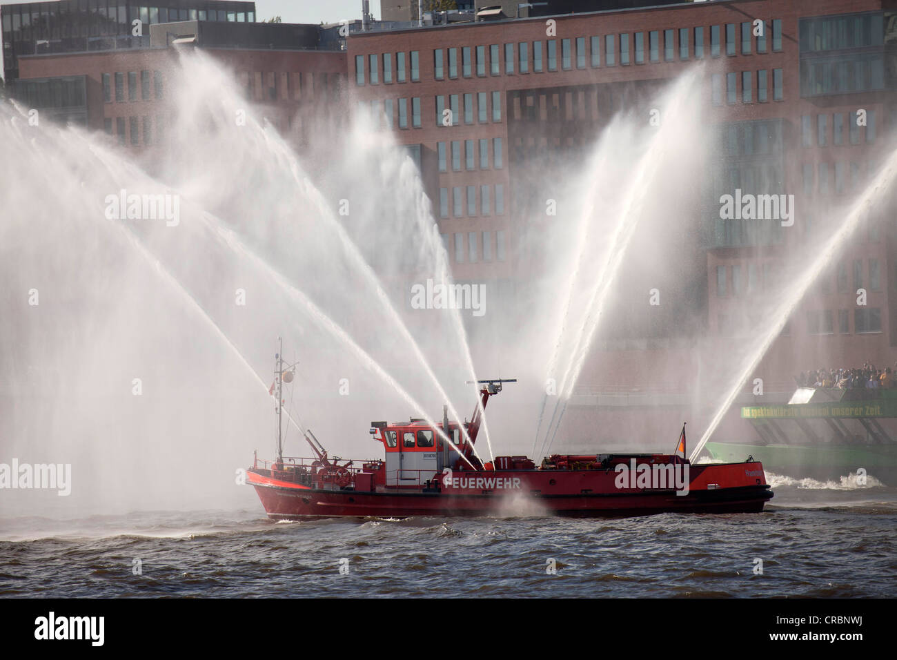 Fire boat spouting water in all directions, Hafengeburtstag or Port Anniversary 2011, Hanseatic City of Hamburg, - Stock Image
