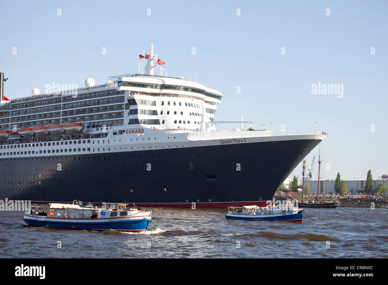 Cruise liner, Queen Elizabeth 2, during the parade of ships during the birthday celebrations for the port of Hamburg - Stock Image