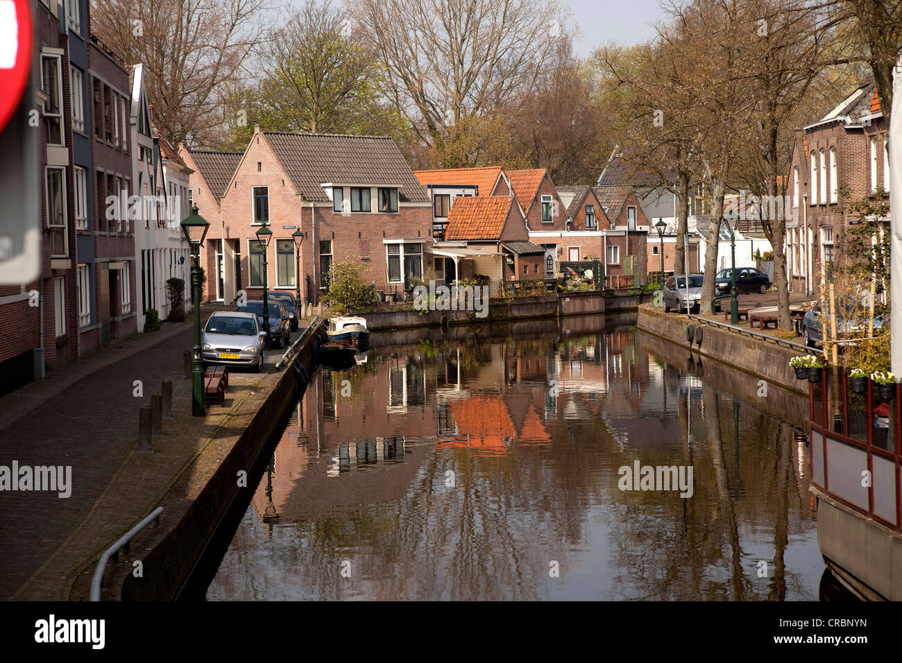 Canal and houses in Alkmaar, North Holland, Netherlands, Europe - Stock Image