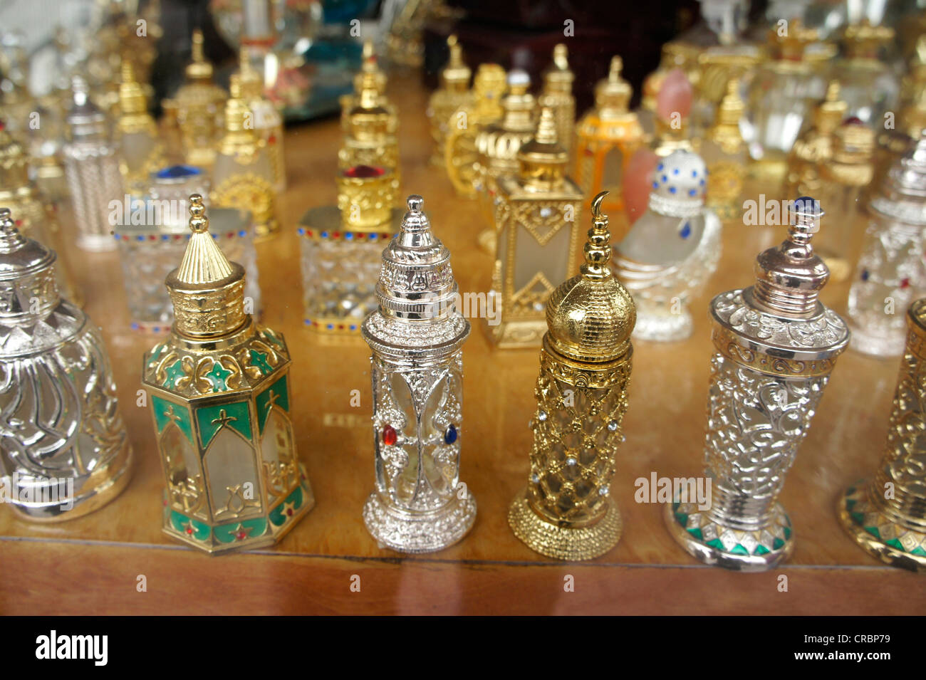 Perfume bottles in a shop window in Dubai, United Arab Emirates, Middle East, Asia - Stock Image