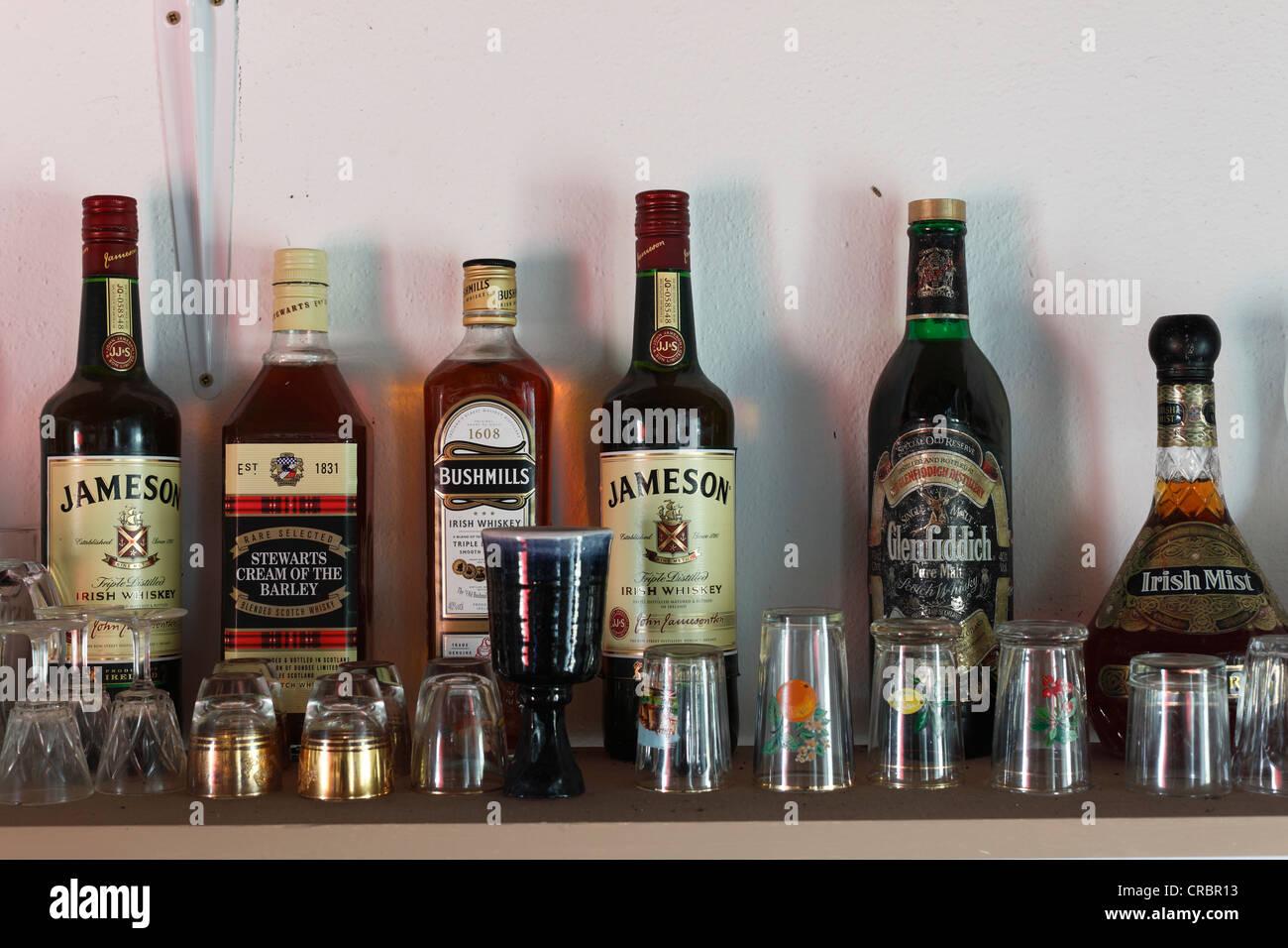 Whiskey bottles, Father Mcdyer Folk Museum, Glencolumbcille, also Glencolumbkille, County Donegal, Ireland, Europe - Stock Image