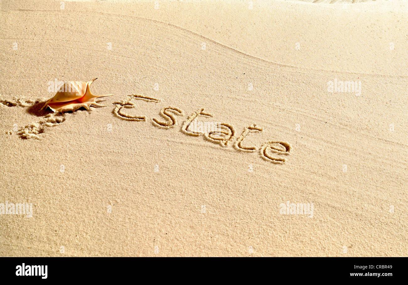 Estate written in sand - Stock Image
