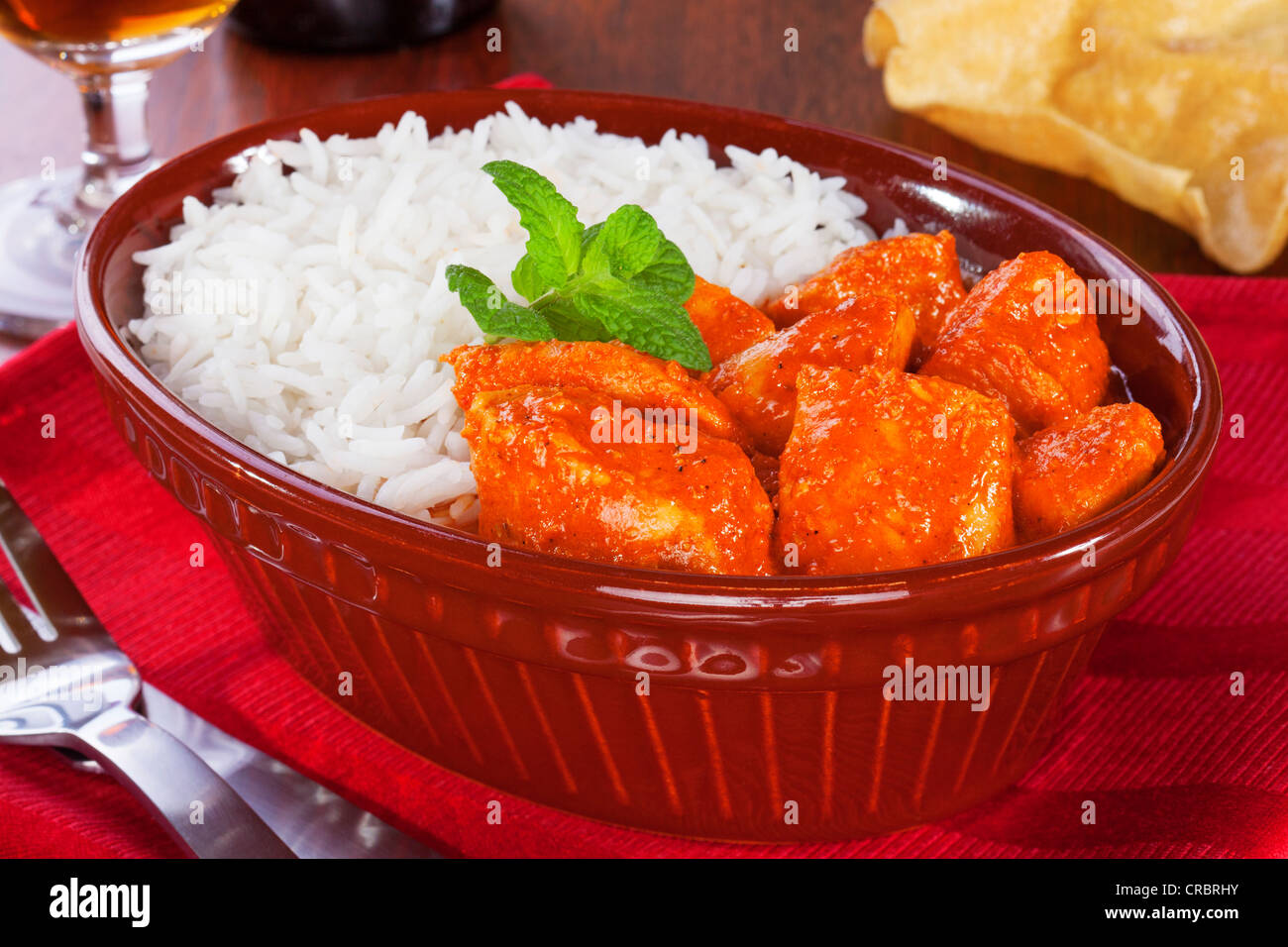 Chicken curry and rice, as served in a pub, in an old pie dish. - Stock Image