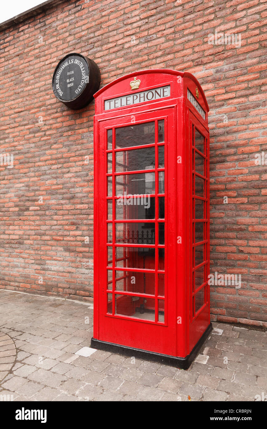 Old telephone box, Bushmills Distillery, Bushmills, County Antrim, Northern Ireland, Great Britain, Europe - Stock Image