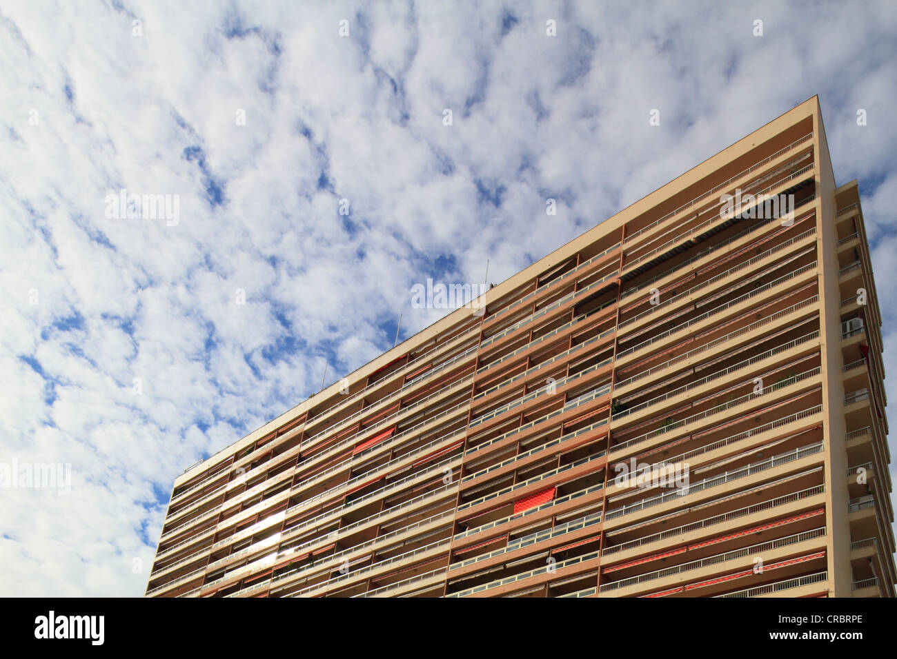 High-rise building against fluffy clouds, Larvotto quarter, Principality of Monaco, Cote d'Azur, Europe - Stock Image