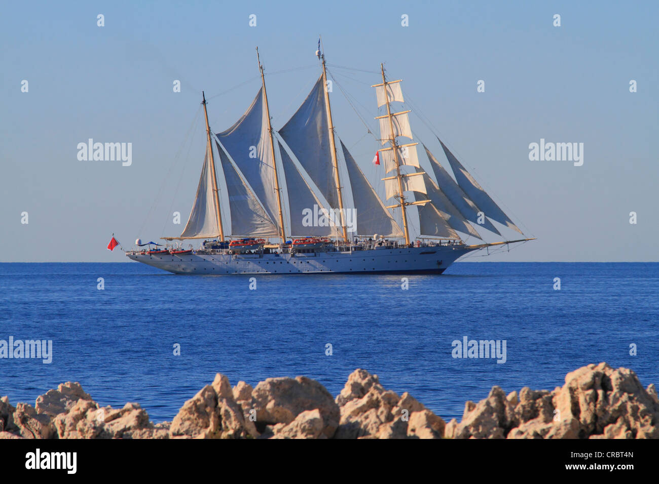 Sailing cruise ship, Star Flyer, at Cap Martin on the way to Monaco, Côte d'Azur, France, Europe Stock Photo