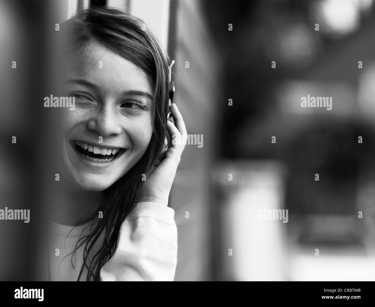 Smiling girl talking on cell phone - Stock Image
