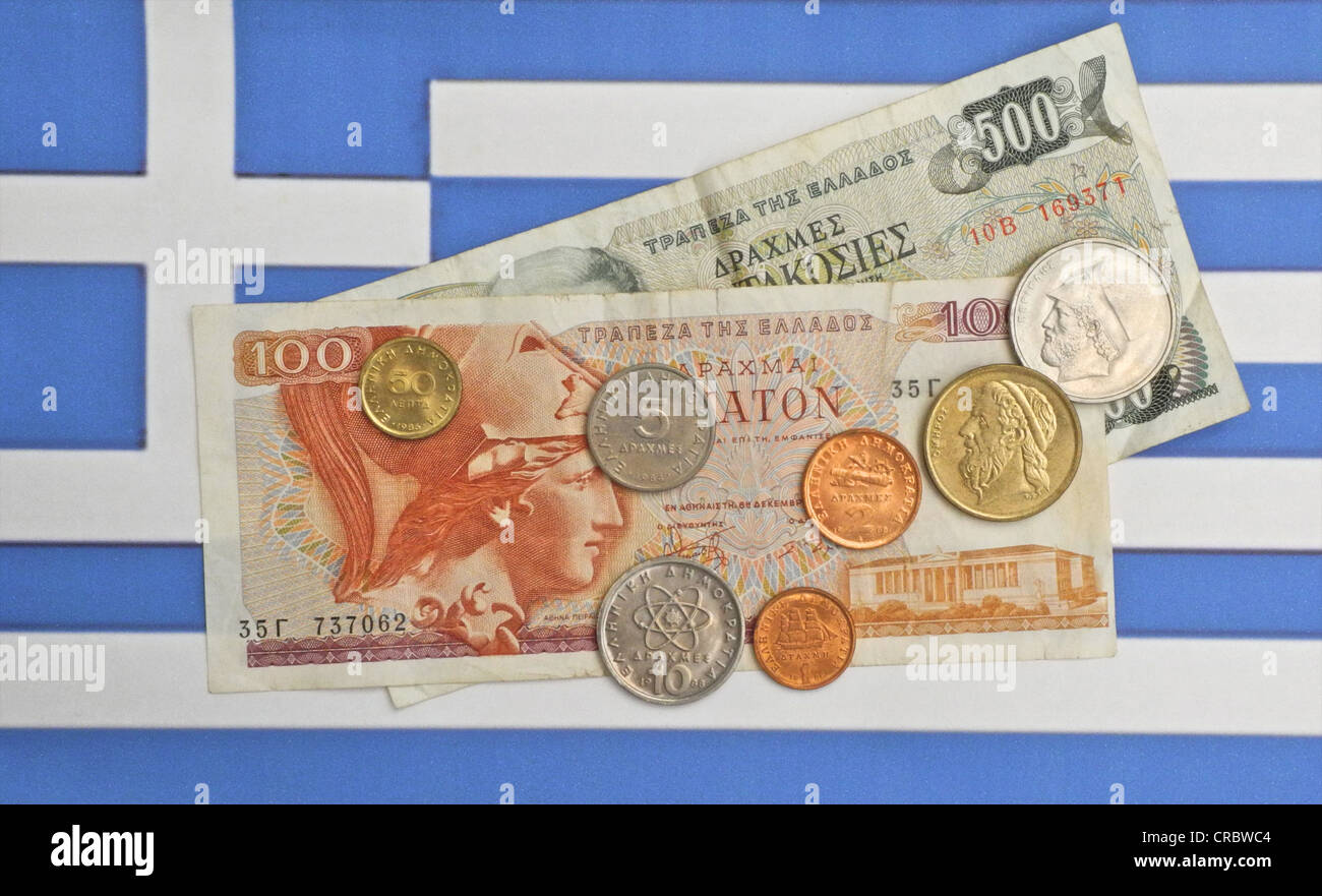 Drachma Greek currency on the flag of Greece. - Stock Image