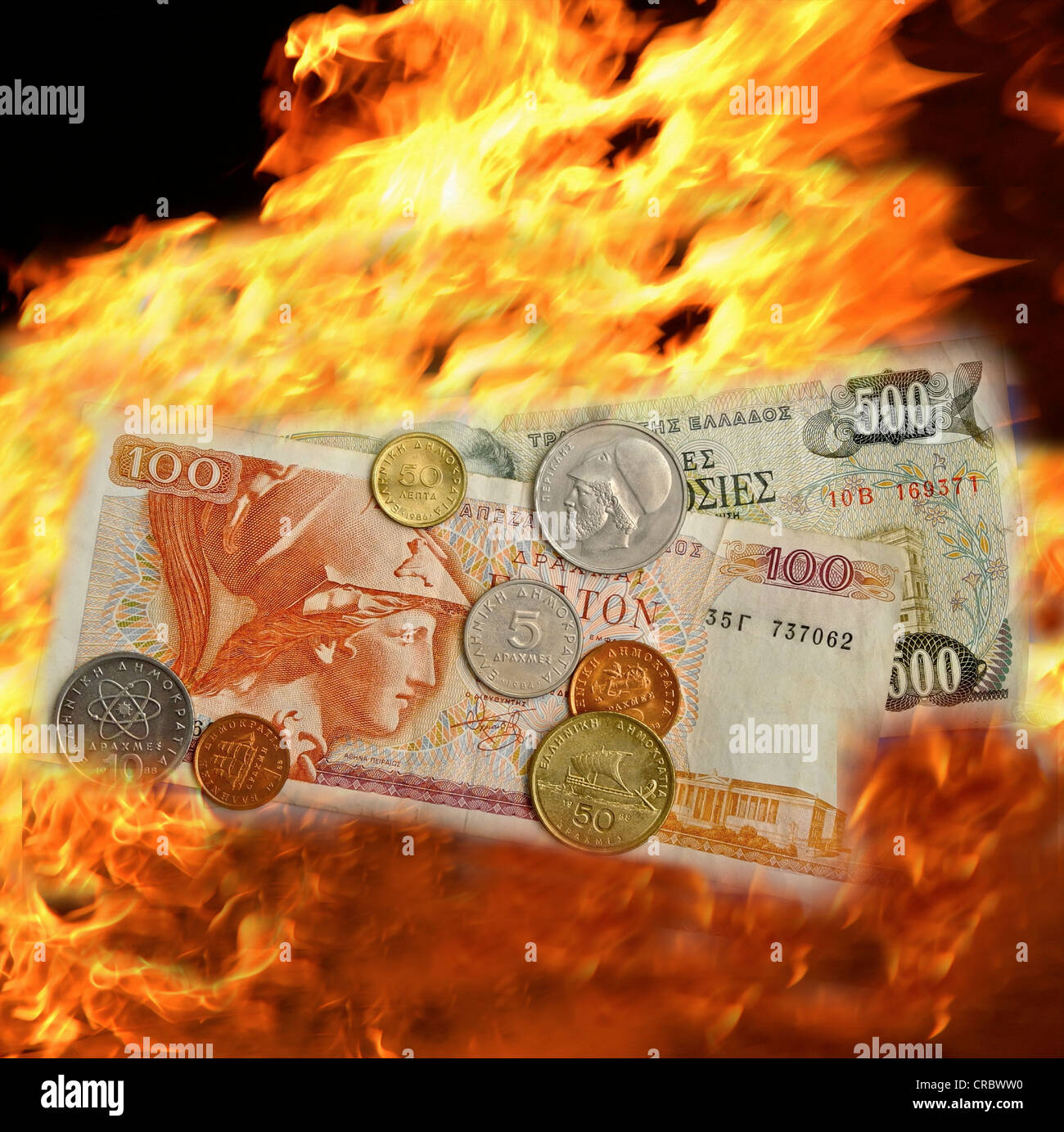 Drachma burning in flames Greek currency - Stock Image