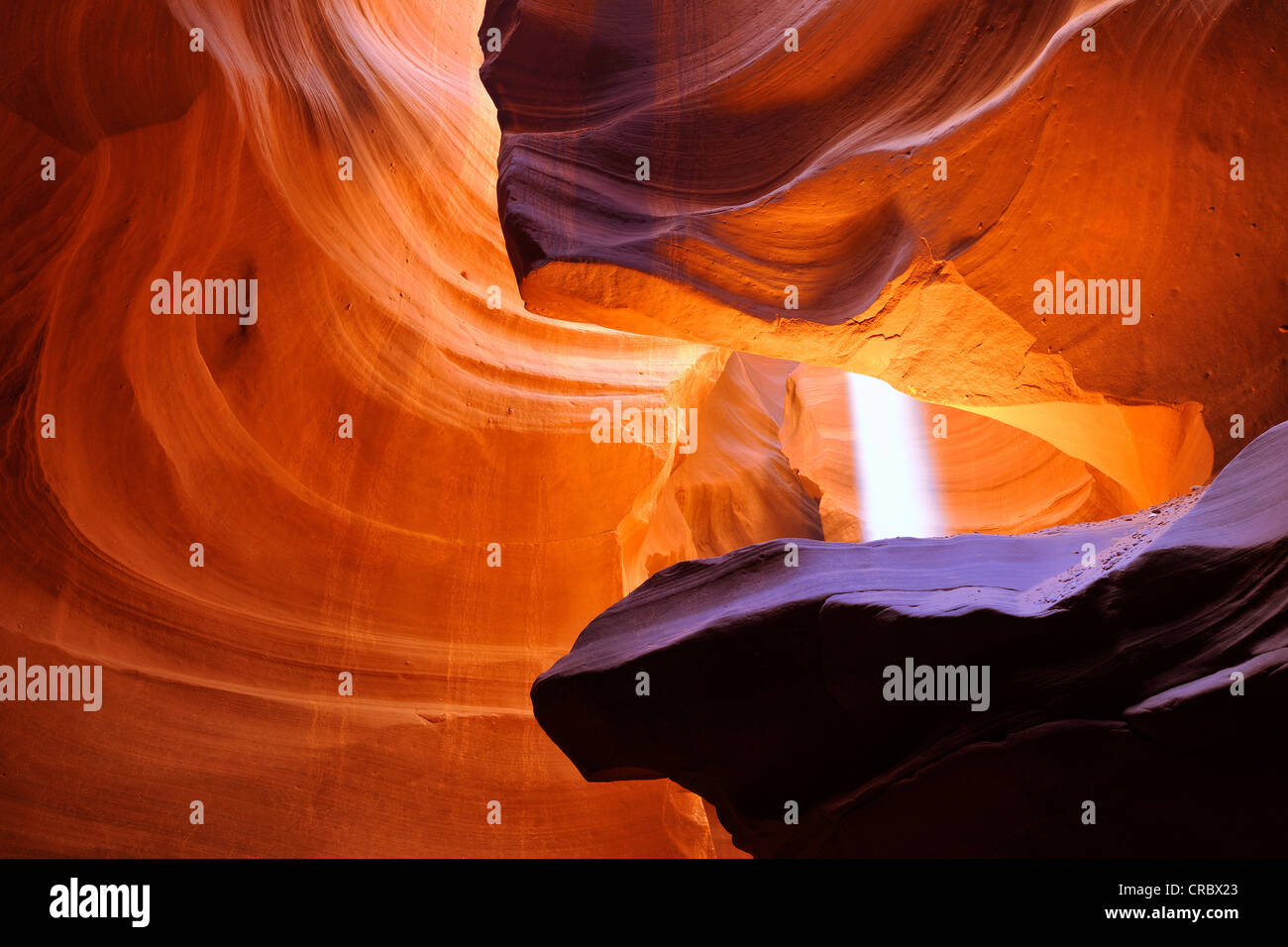 Beam of light, red sandstone of the Moenkopi formation, rock formations, colours and textures in the Upper Antelope - Stock Image