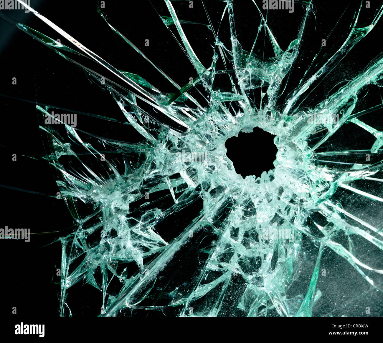 car windscreen with bullet hole in it - Stock Image