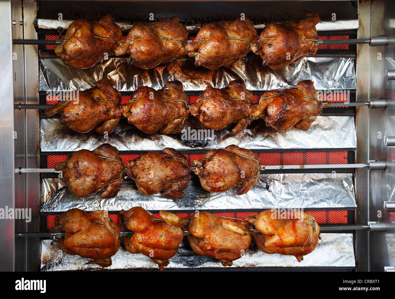 Fried chicken on a grill, Klosterbraeustueberl Reutberg, brewery tavern of Reutberg Abbey, Sachsenkam municipality - Stock Image