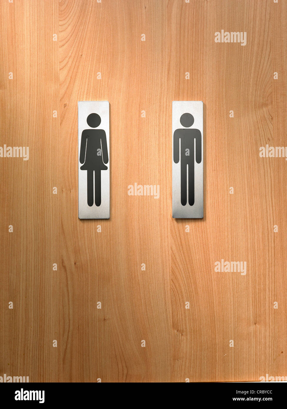 Male and female toilet signs on wooden background - Stock Image