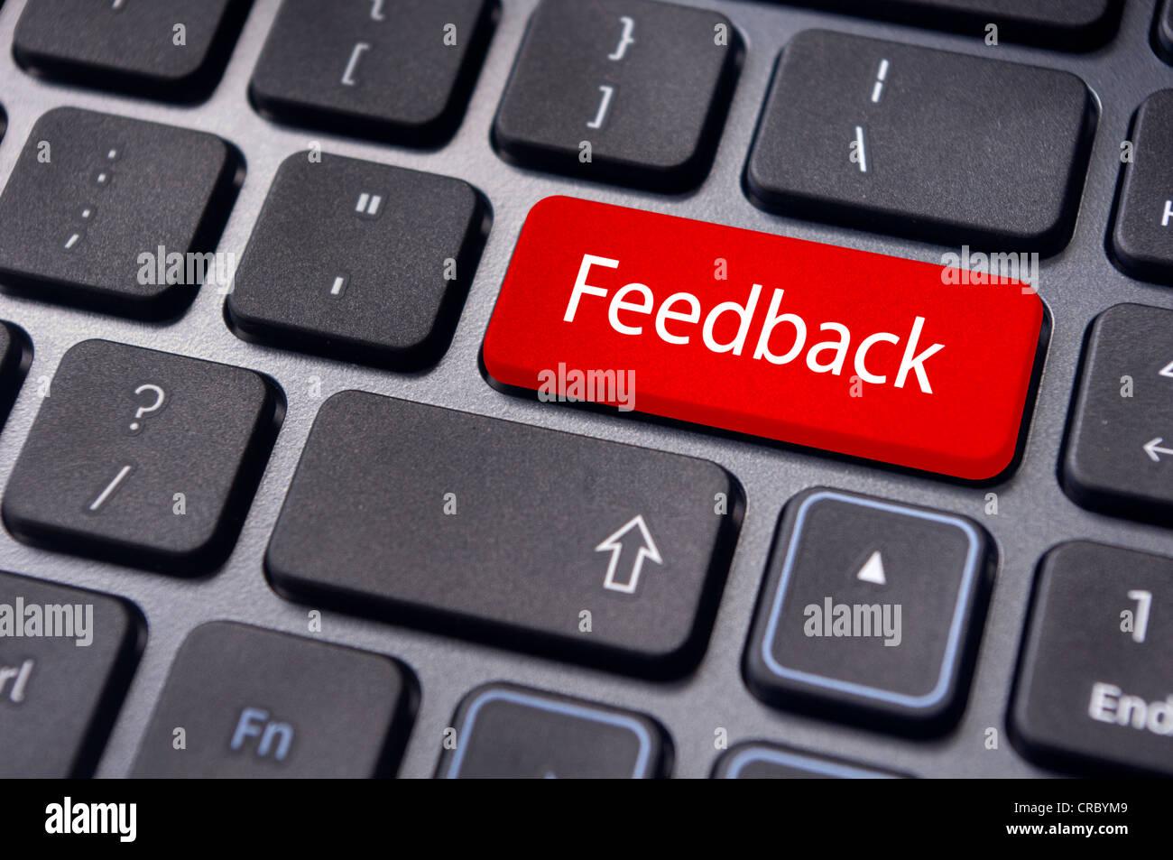 to illustrate feedback concepts through internet, with message on keyboard key. - Stock Image