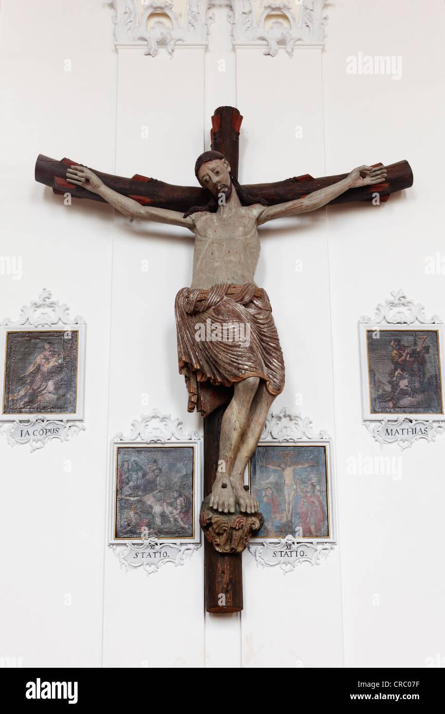 Romanesque crucifix with four nails, parish church of St. Johann, former monastery church, Wessobrunn, Pfaffenwinkel - Stock Image