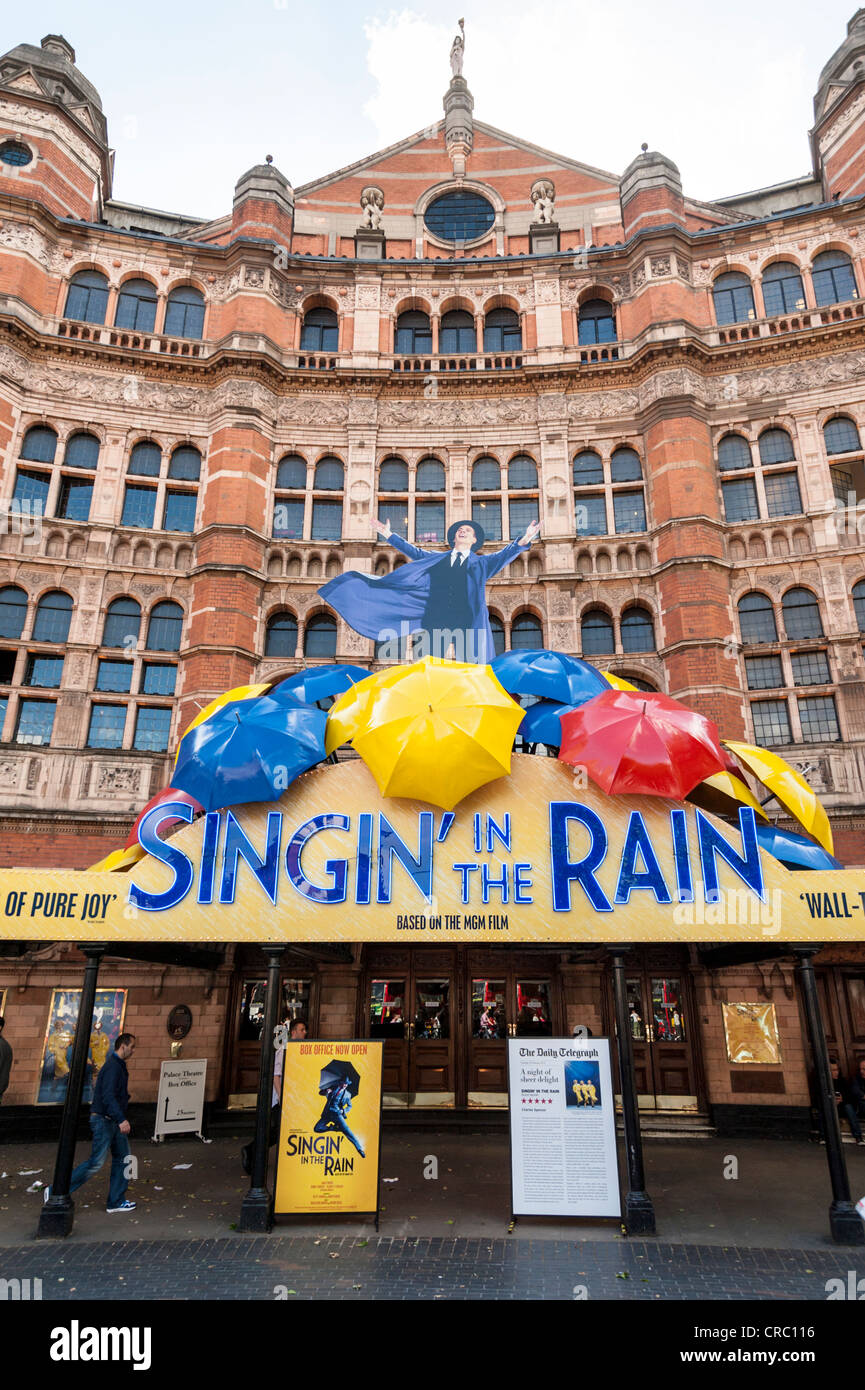 The Palace Theatre Shaftesbury Avenue London UK withe Singing in the Rain signs outside - Stock Image
