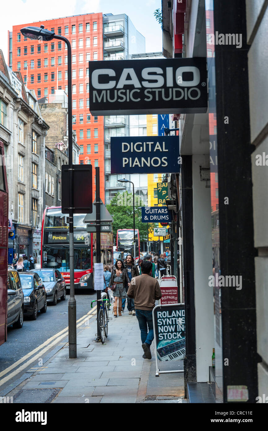 Street scene in Denmark Street London sometimes called tin pan alley famous for its many guitar and musical instrument - Stock Image