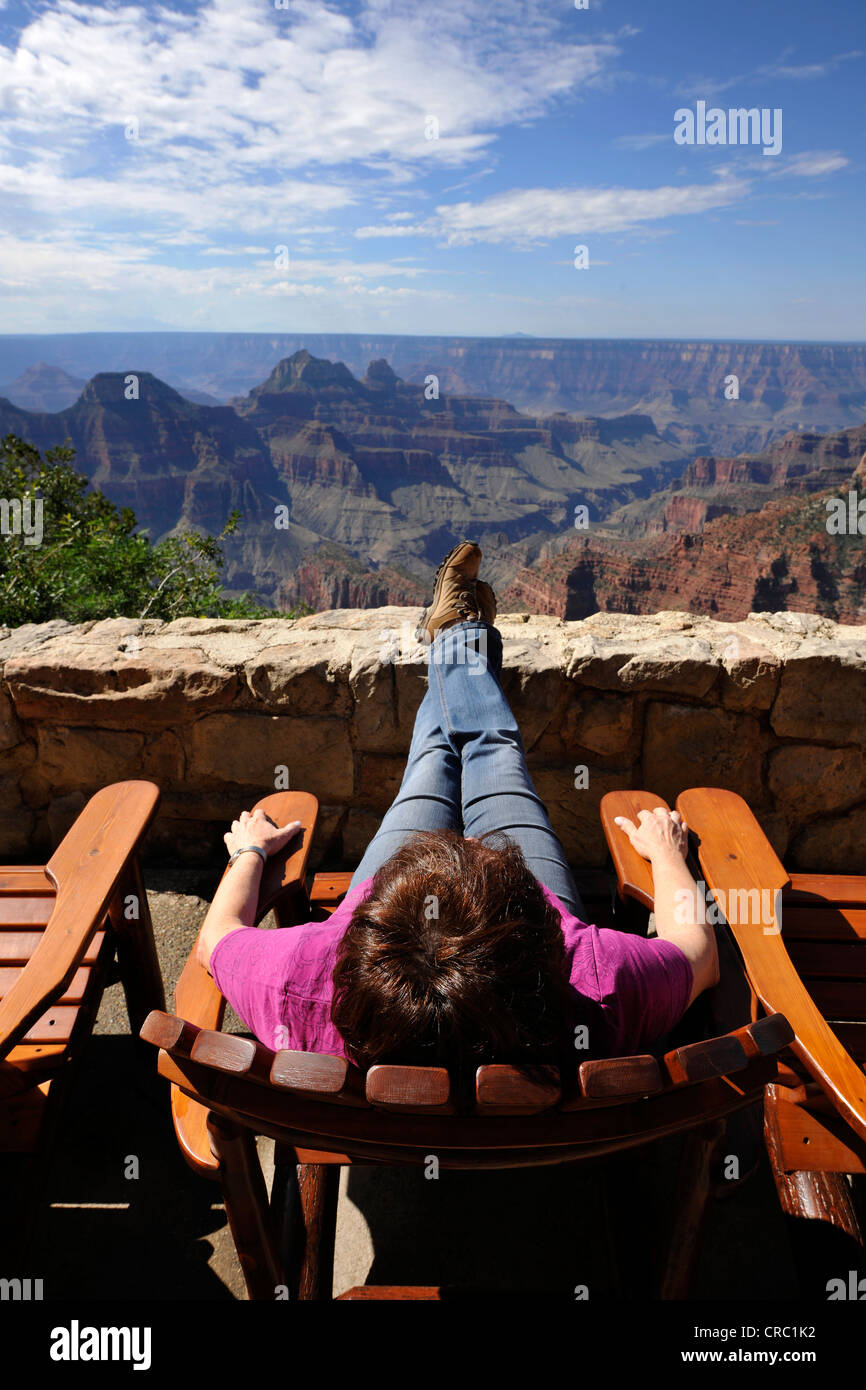 Holidaymaker enjoying the view from the terrace of the Grand Canyon Lodge towards Deva Temple, Brahma Temple - Stock Image