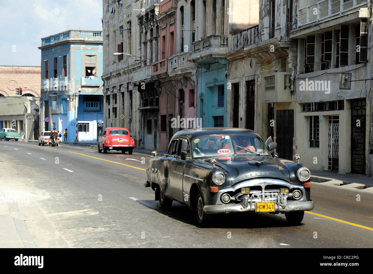 Taxi, black classic car of the 1950's driving in the city centre of Havana, Centro Habana, Cuba, Greater Antilles, - Stock Image