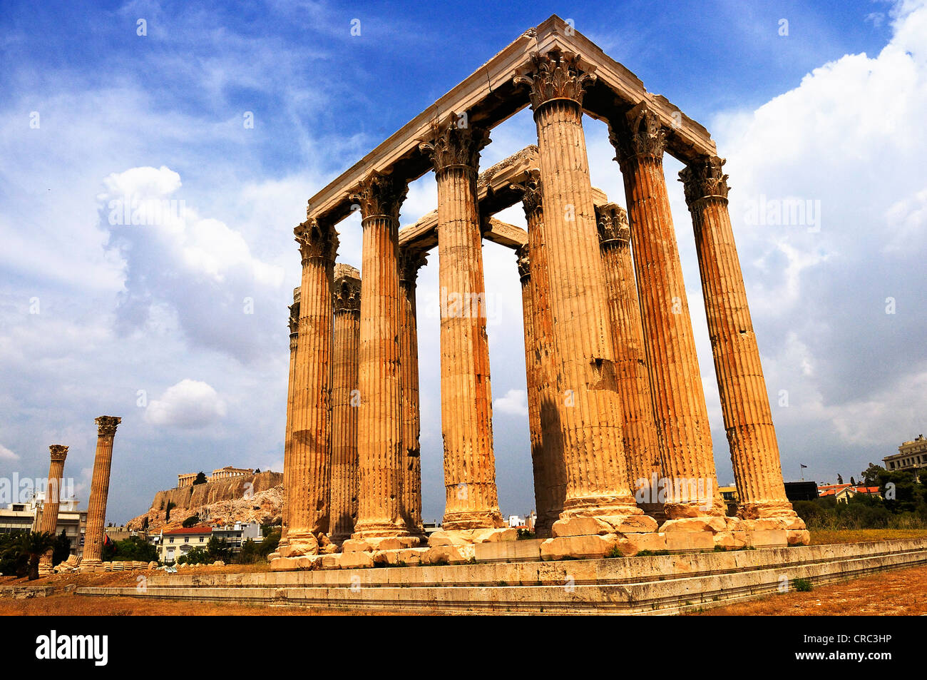 Temple of the Olympian Zeus and the Acropolis in Athens, Greece - Stock Image