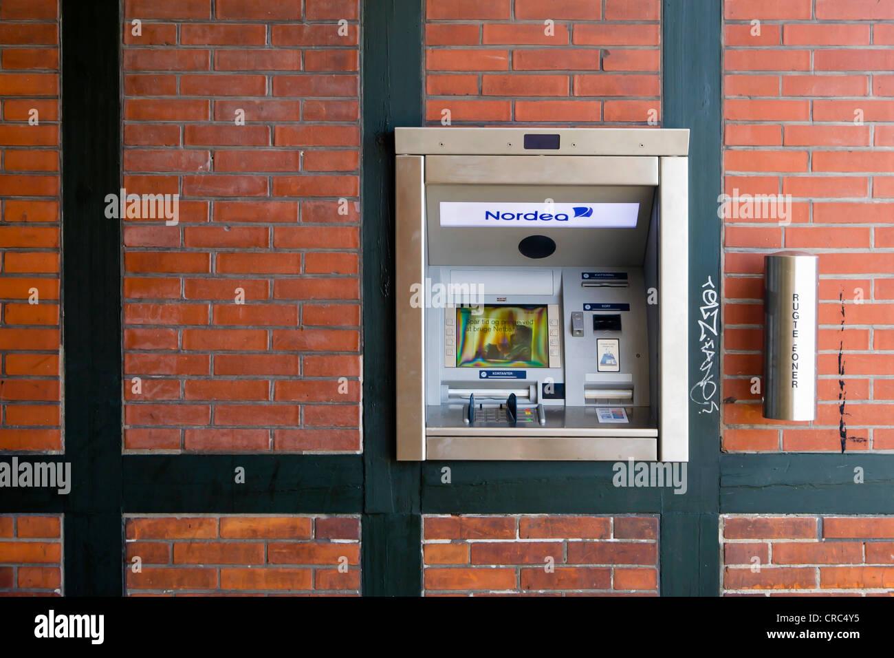 Modern cash dispenser built into a half-timbering wall, Copenhagen, Denmark, Europe - Stock Image