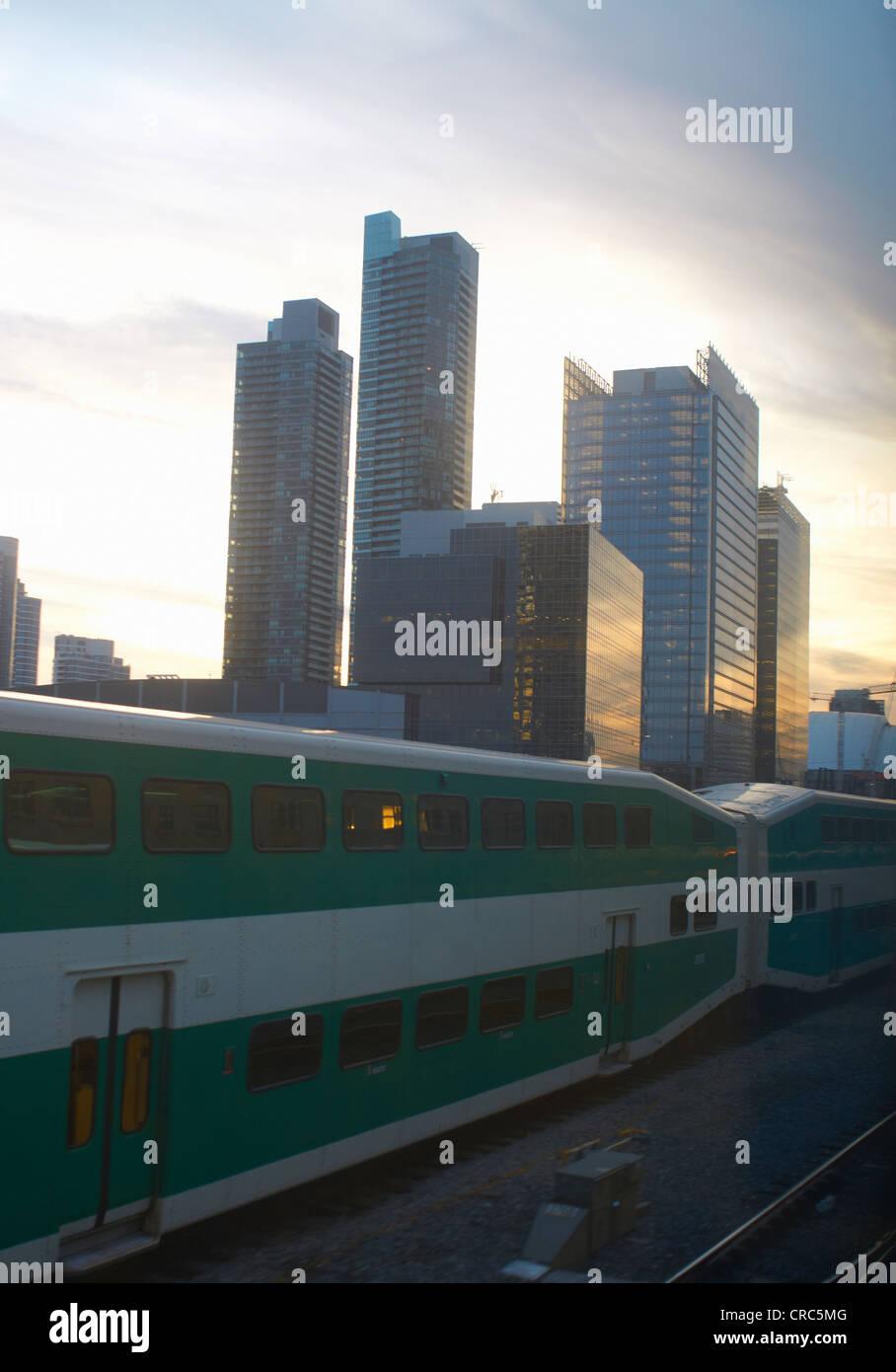 Train passing by Toronto city skyline - Stock Image