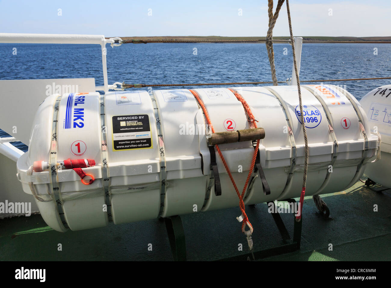 Inflatable survival liferaft with flare on the deck of the island ferry from Kirkwall to Westray. Orkney Islands, - Stock Image