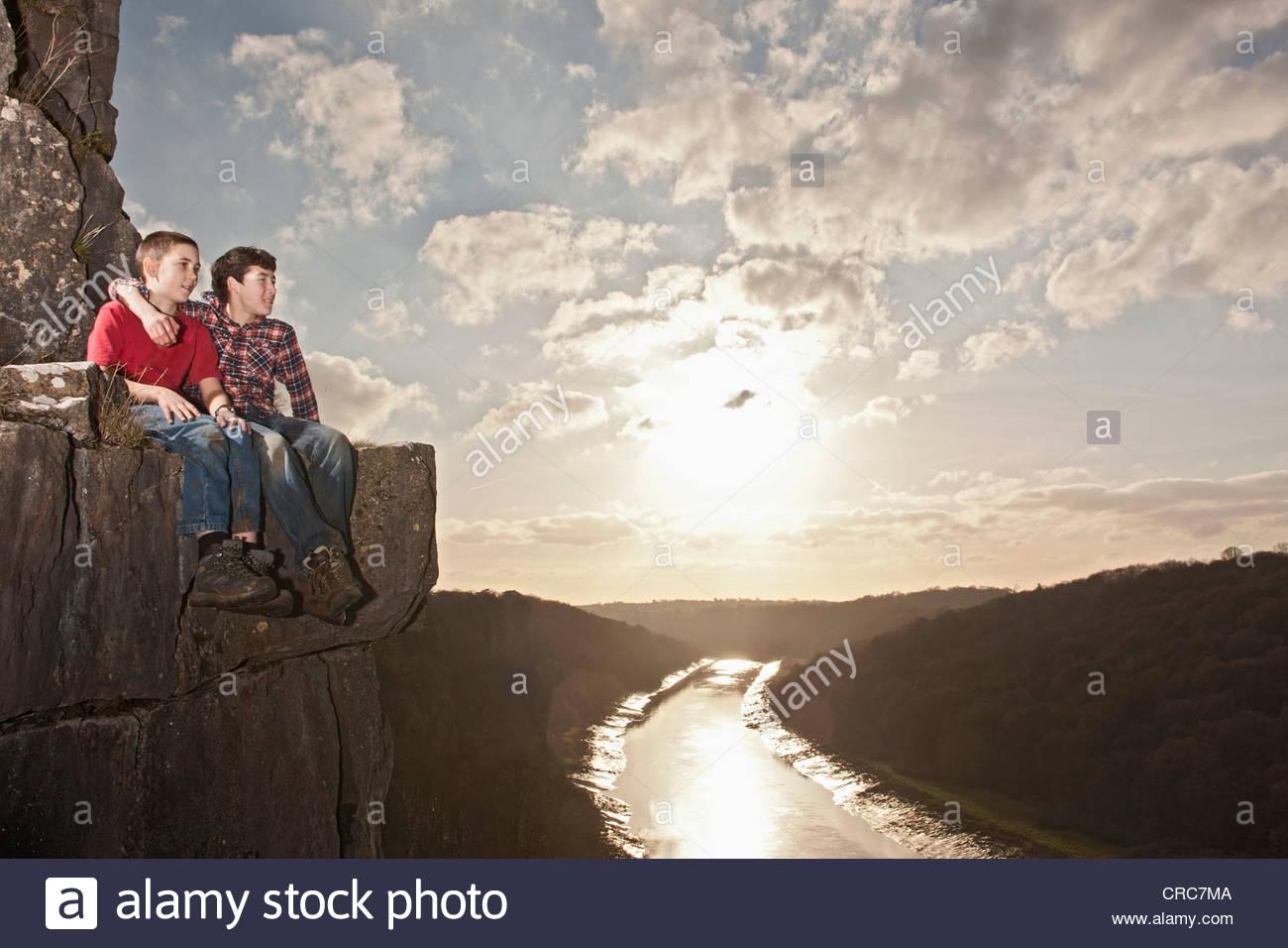 Boys on ledge at Wintour's Leap cliffs - Stock Image