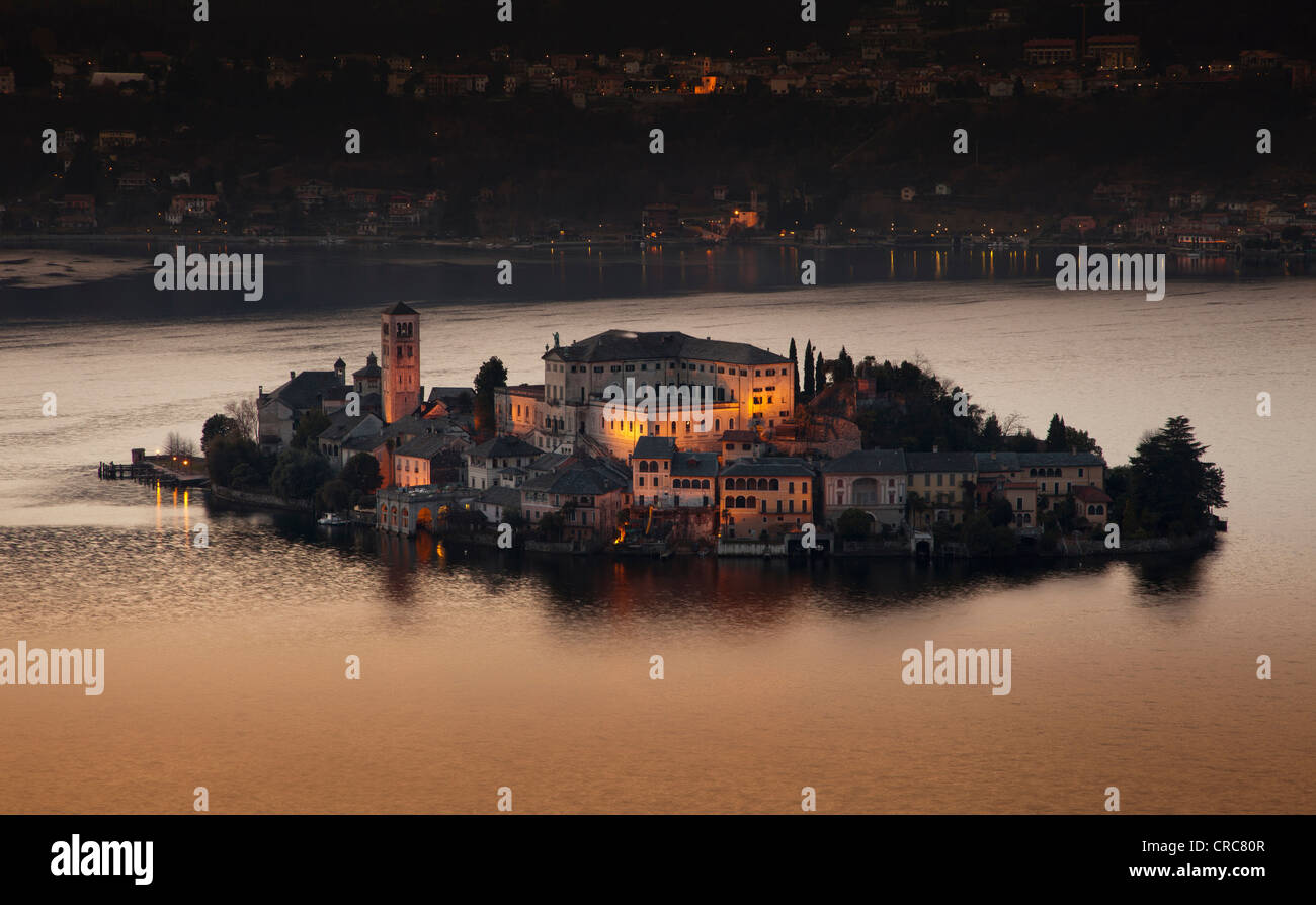 Village on island lit up at night - Stock Image