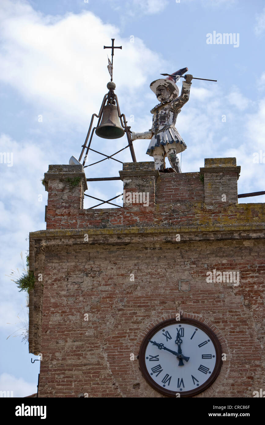 Dilapidated statue on clock tower - Stock Image