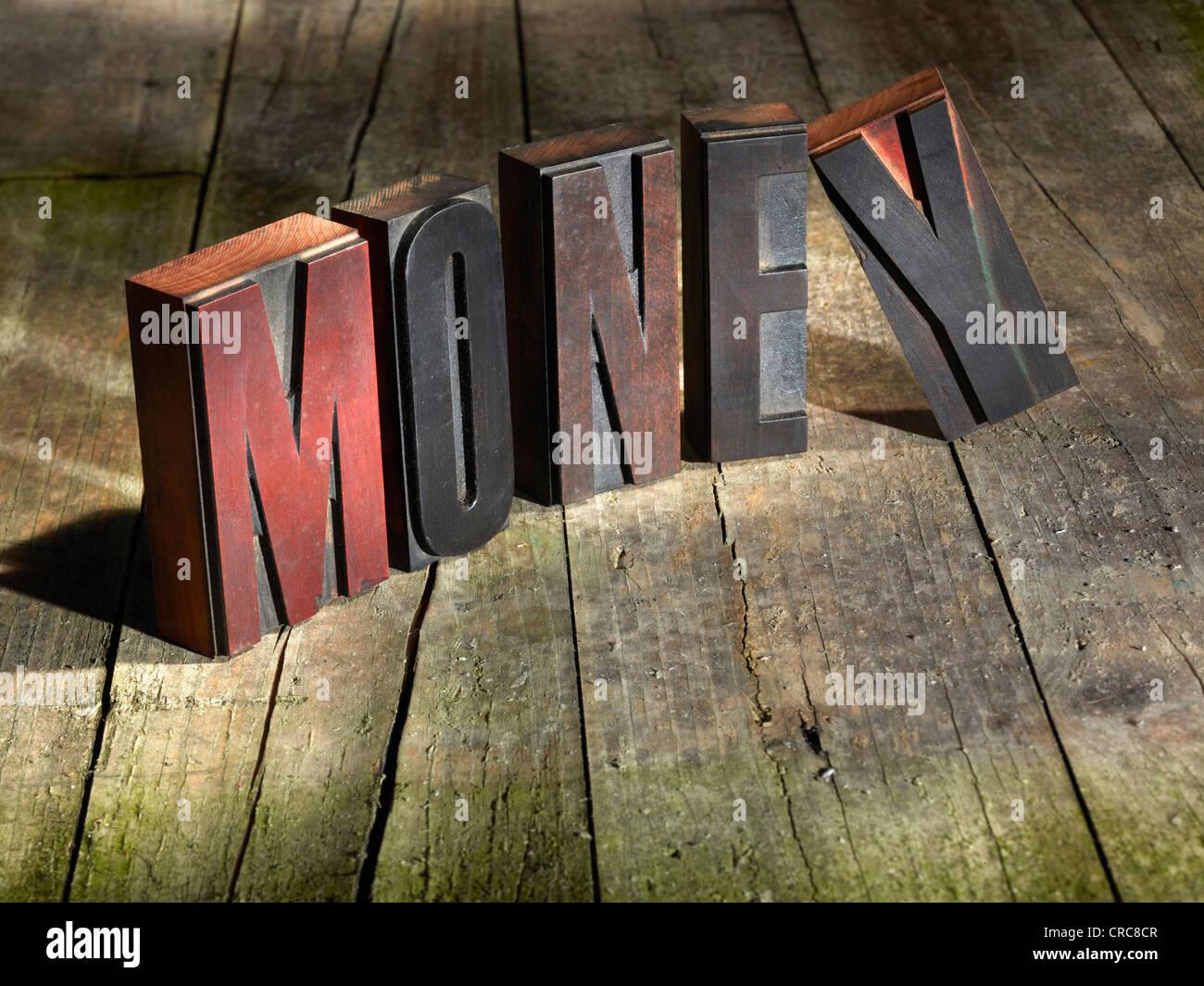 Wooden blocks spelling money - Stock Image