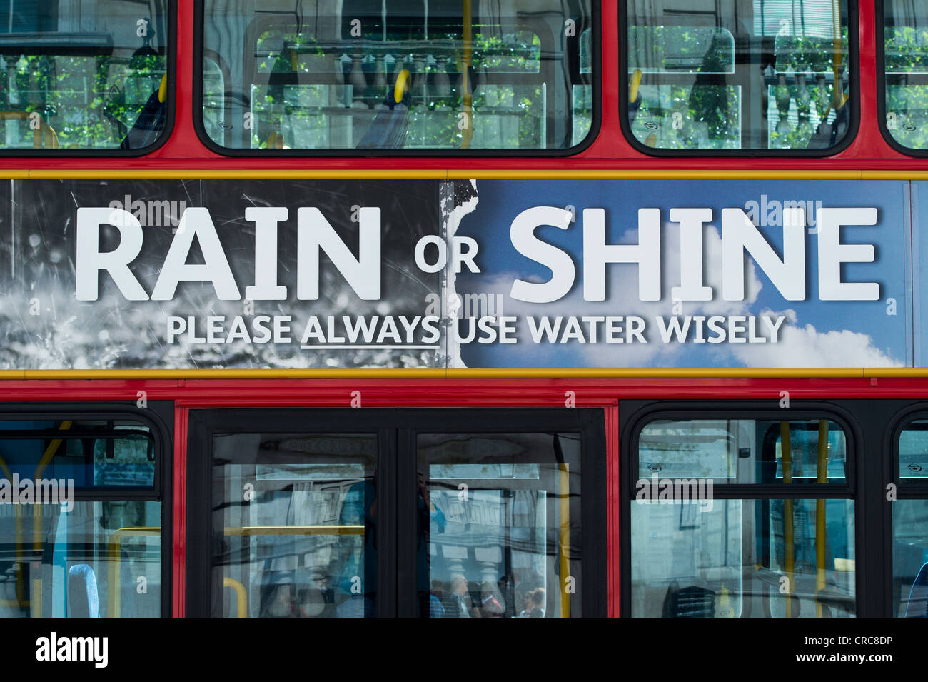 Rain or Shine water advert on the side of a double decker bus. London. England - Stock Image