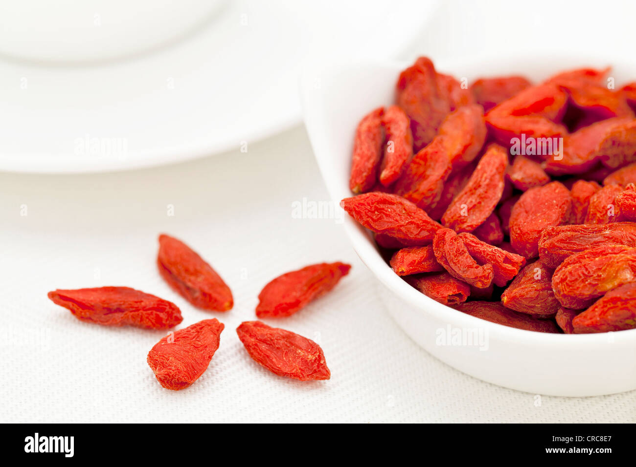 organic dried goji berries (wolfberry) in a small ceramic bowl Stock