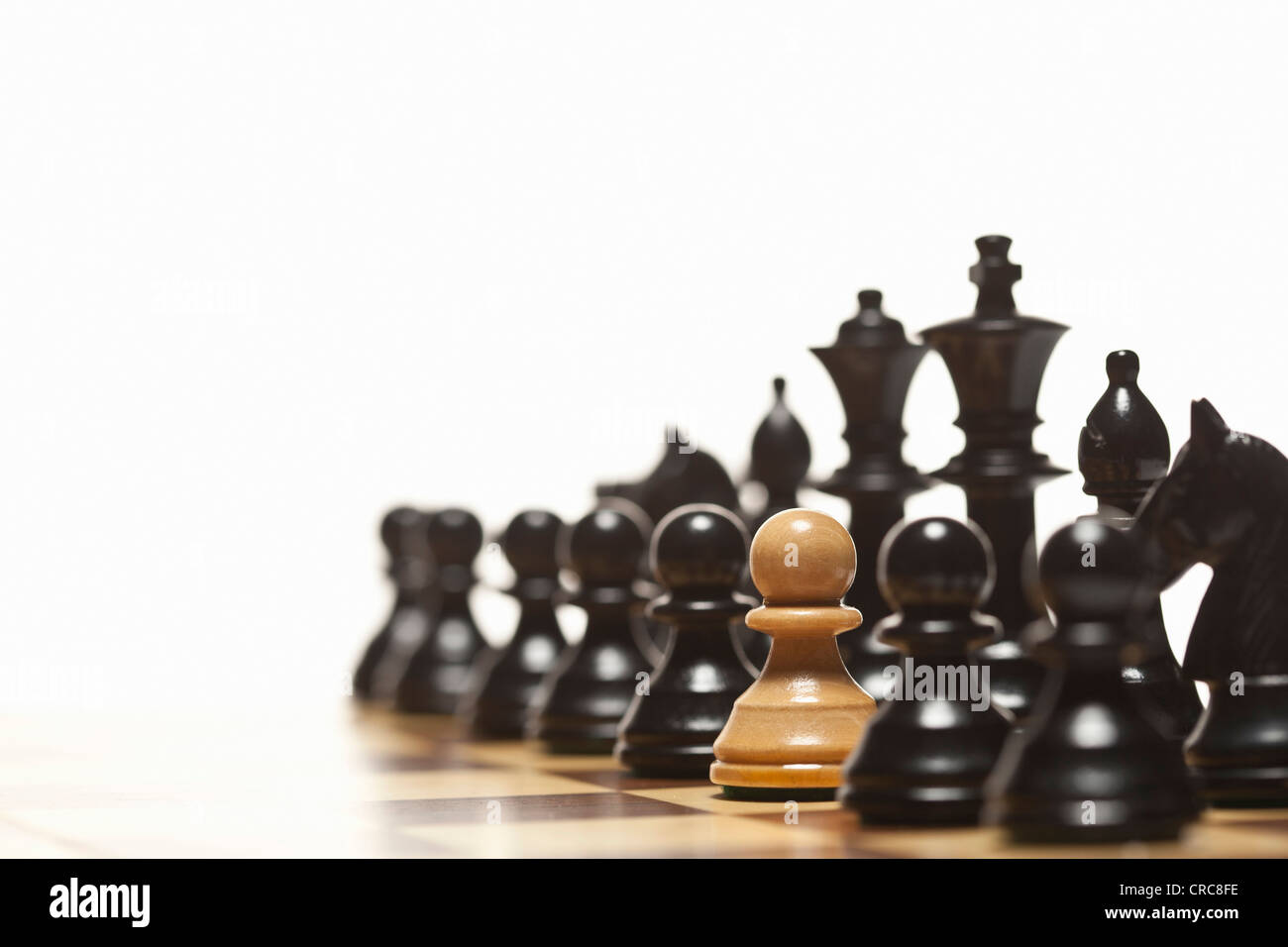 White pawn in black chess set - Stock Image