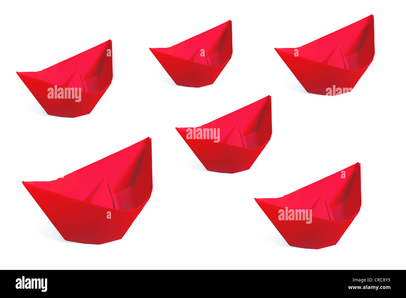 Red paper ships isolated on a white background - Stock Image