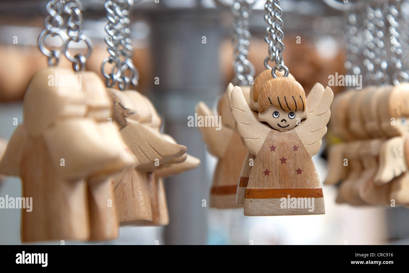 Carved Wooden Angels On A Keyring For Sale In A Shop In The
