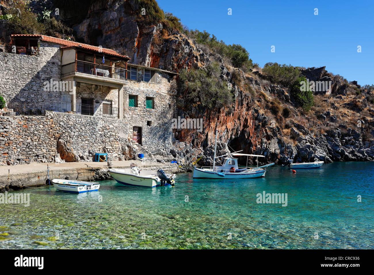 Fishing boats in the village Alypa in Eastern Mani, Greece - Stock Image