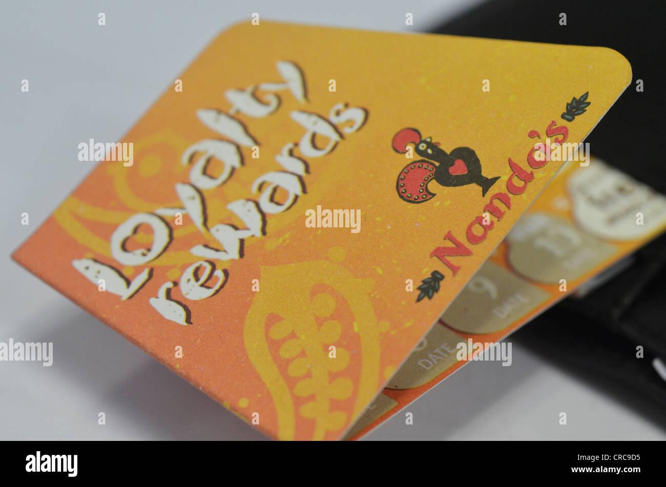 Nando's loyalty reward card from wallet - Stock Image
