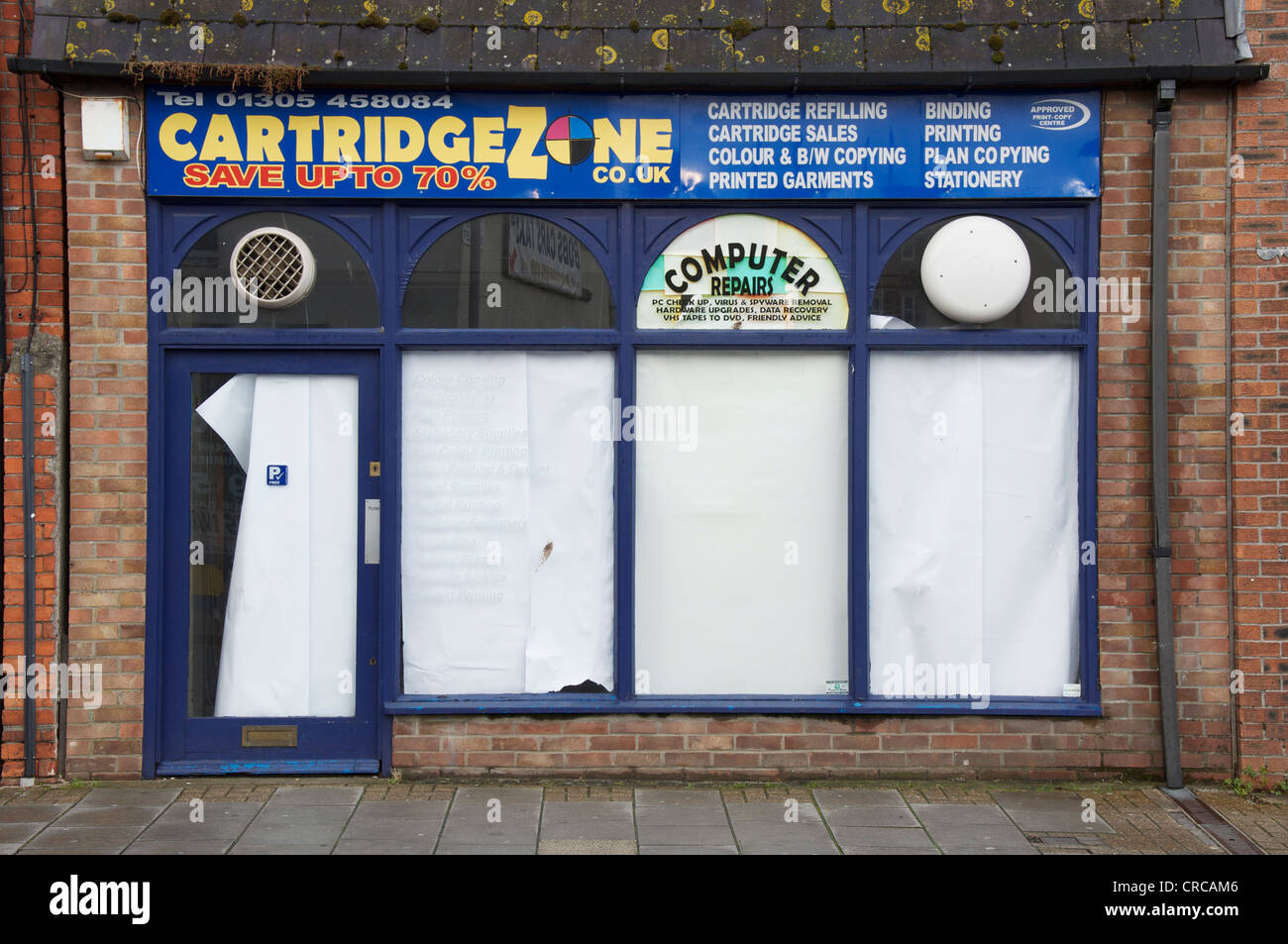 A provider of copying and printing services, closed down, just another of the many high street casualties of the Stock Photo