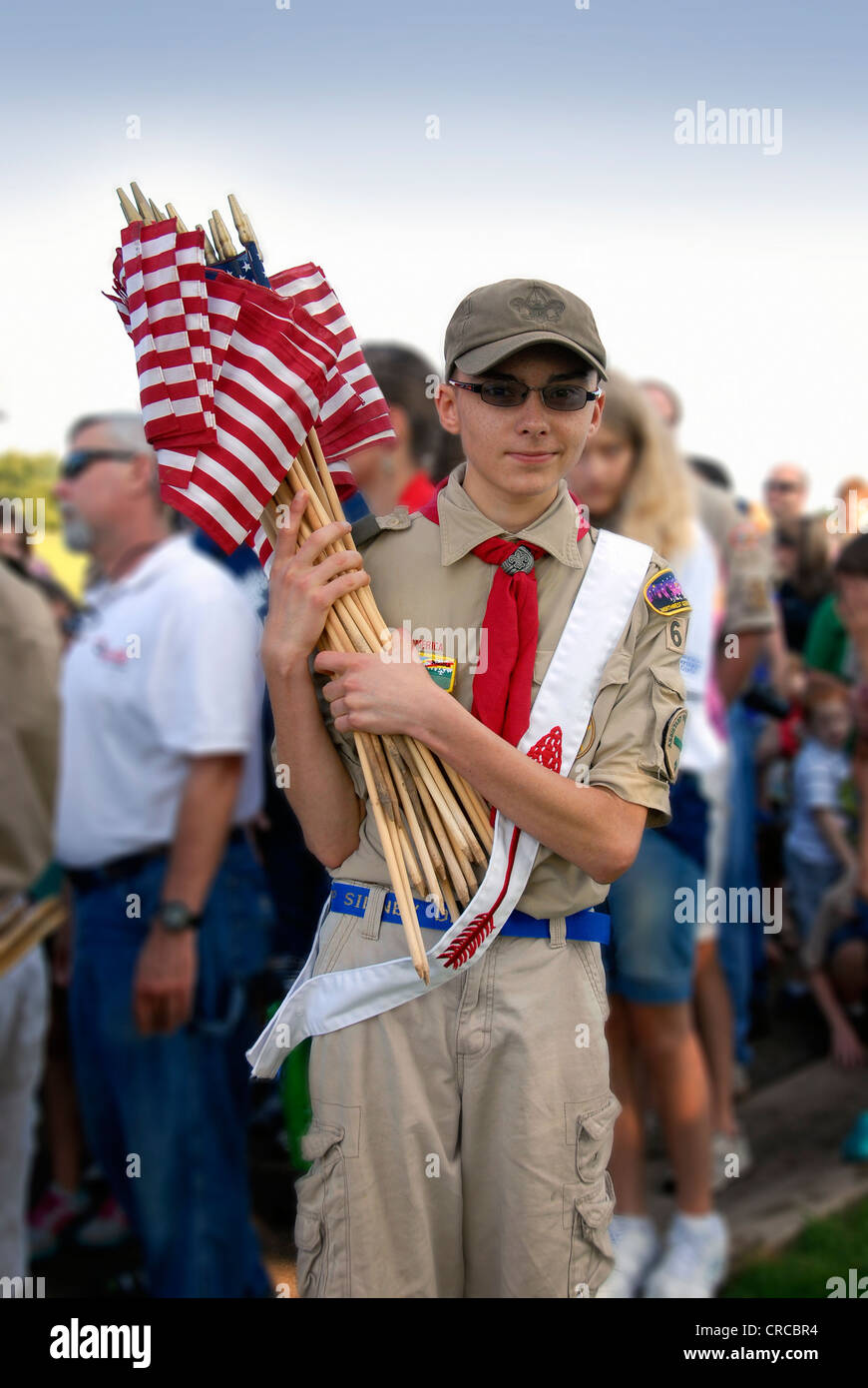 Boy Scout prepares to place American flags at Chattanooga National Cemetery, Memorial Day 2012 - Stock Image