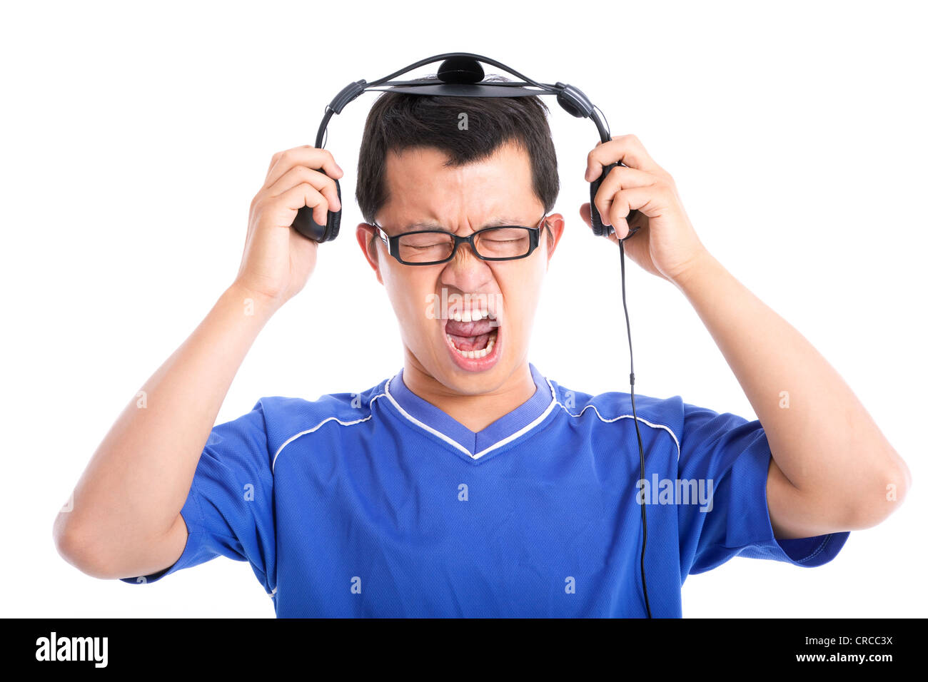 Young man expressing loud sound - Stock Image