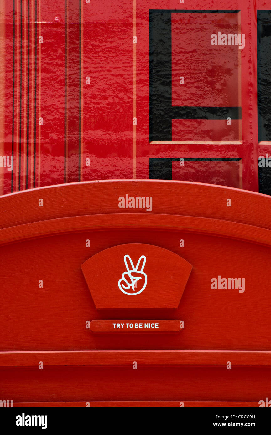 Red telephone box Puma shop frontage. Carnaby Street, London, England - Stock Image