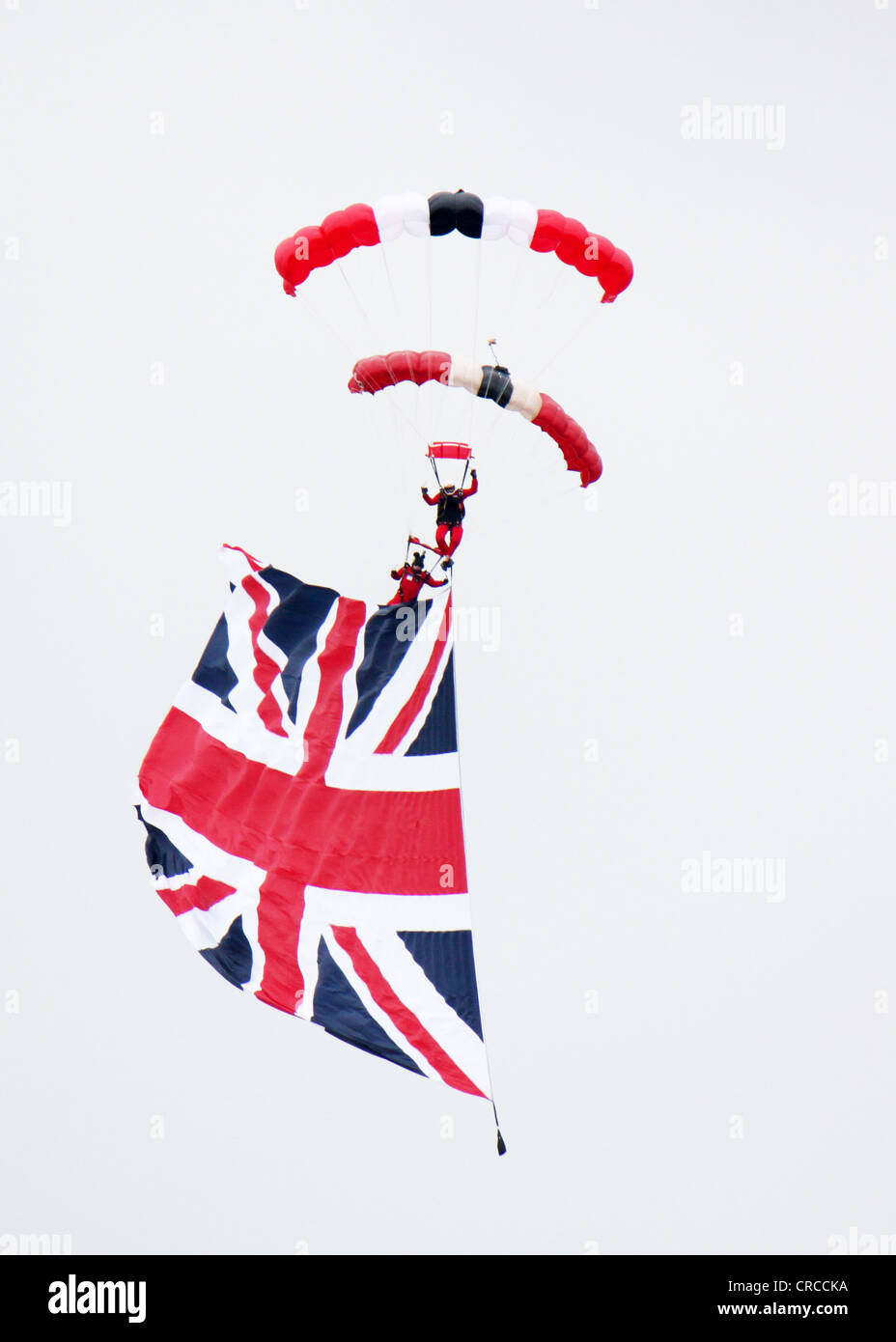 Red Devil's fly the flag at Diamond Jubilee Epsom Derby 2012 - Stock Image