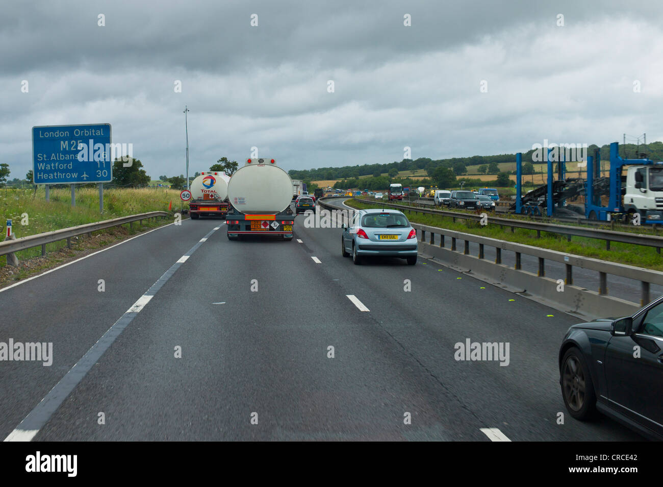 A busy section of the M25, London Orbital Motorway, with a lane closed and the hard shoulder in use. - Stock Image