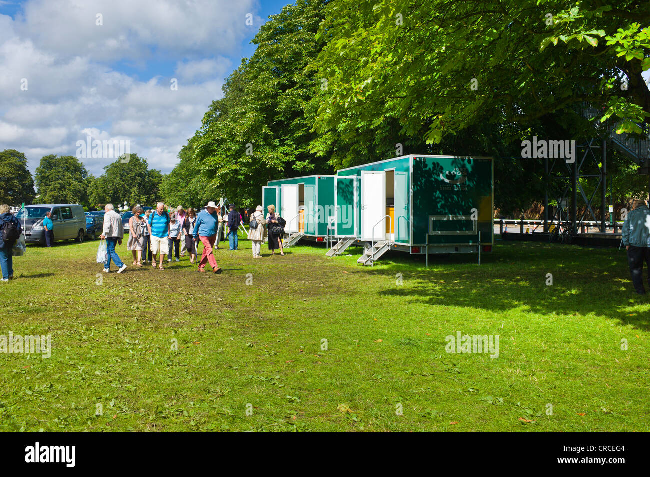 Mobile toilet vans on the car park for Hampton Court Palace flower show - Stock Image