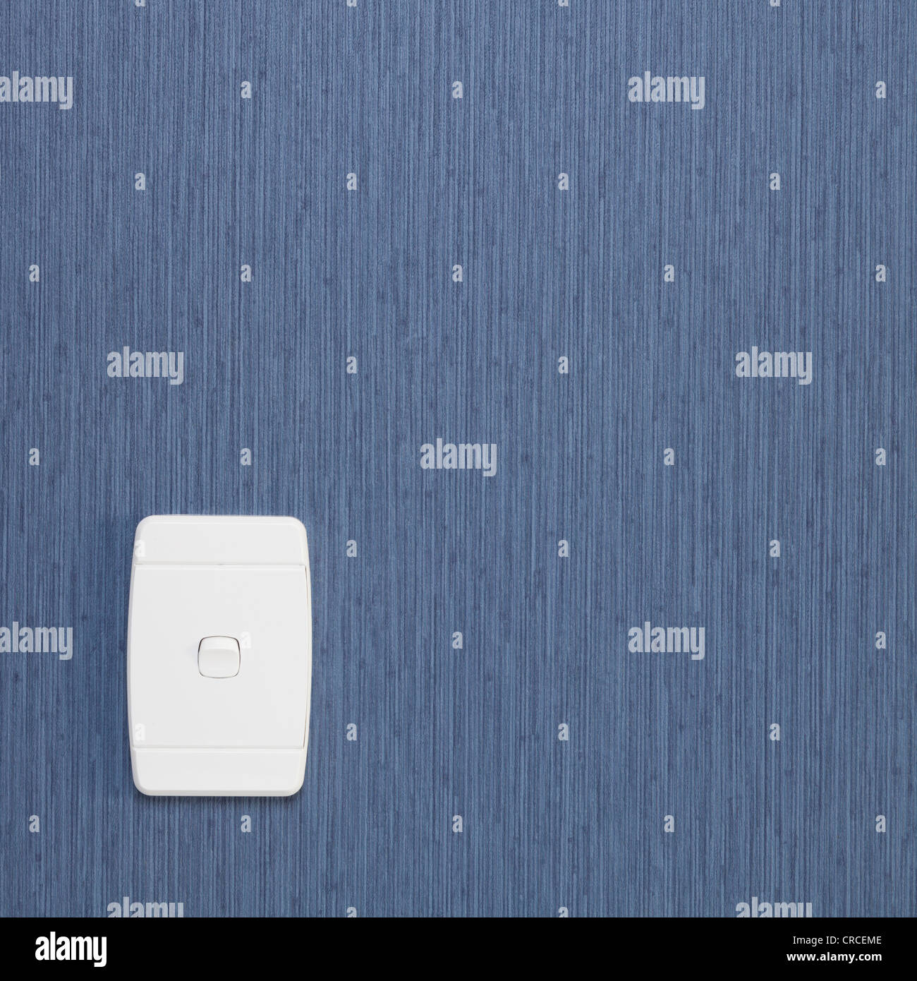Single gang electrical light switch on wall with blue textured wallpaper, square, copy space. - Stock Image
