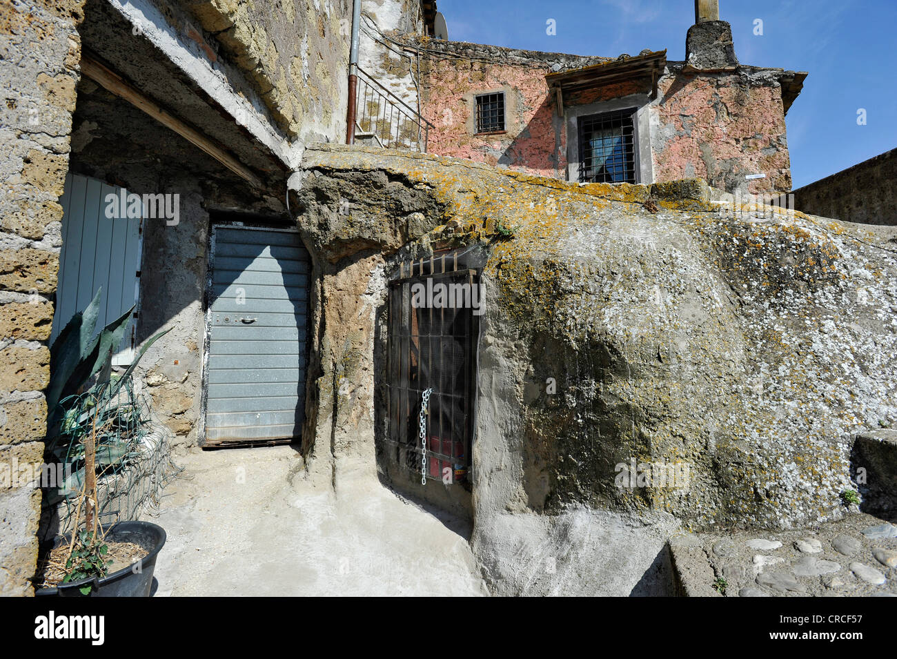 Winding alley with stairways and passages, medieval town of Vecchia Calcata, valley of Valle del Treja, Lazio, Italy, - Stock Image